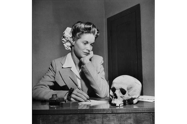A young American woman gazes at a human skull, sent to her by a boyfriend.