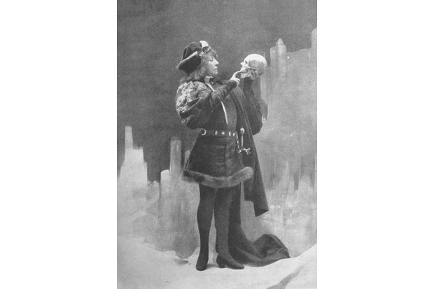 French-born actress Sarah Bernhardt performs as William Shakespeare's Hamlet. She is pictured holding a skull.