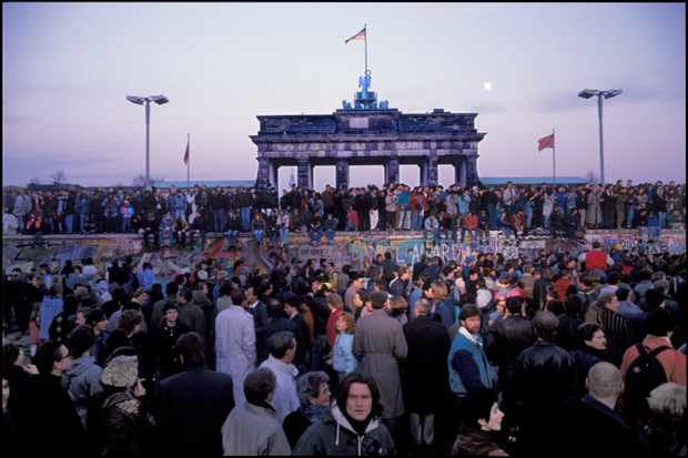 East Germans crowd around and on the Berlin Wall the day after the gates opened for free movement in 1989
