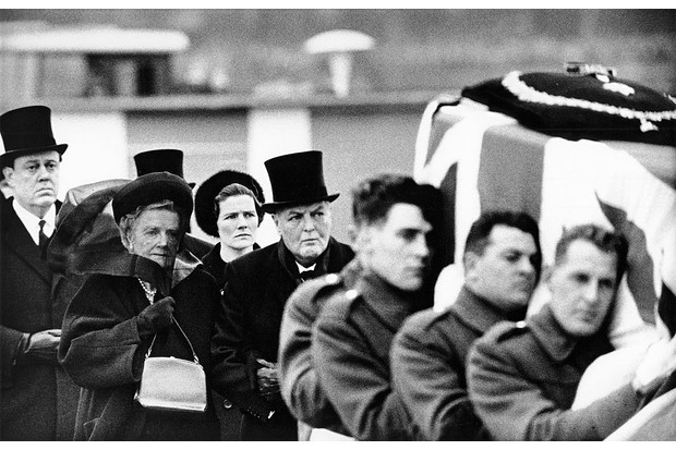 Lady Clementine Churchill (second from left) is escorted on the arm of her son Randolph as they follow the coffin of her husband, Winston Churchill