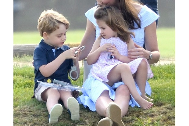 GLOUCESTER, ENGLAND - JUNE 10: (EMBARGOED FOR PUBLICATION IN UK NEWSPAPERS UNTIL 24 HOURS AFTER CREATE DATE AND TIME) Princess Charlotte of Cambridge and Prince George of Cambridge attend the Maserati Royal Charity Polo Trophy at Beaufort Park on June 10, 2018 in Gloucester, England. (Photo by Karwai Tang/WireImage)