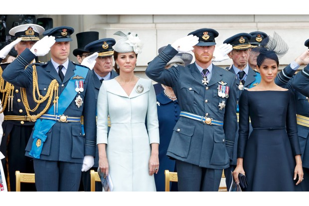 Prince William, Duke of Cambridge, Catherine, Duchess of Cambridge, Prince Harry, Duke of Sussex and Meghan, Duchess of Sussex attend a ceremony to mark the centenary of the Royal Air Force on the forecourt of Buckingham Palace on 10 July 2018 in London, England. (Photo by Max Mumby/Indigo/Getty Images)