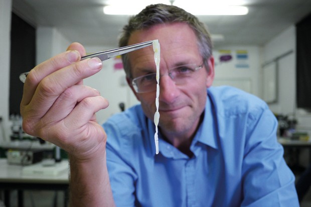 Dr Michael Mosley holds up a tapeworm