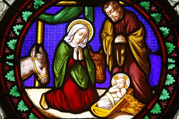 A stained glass depiction of the nativity.