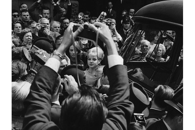 Mandy Rice-Davies and Christine Keeler in a crowd of photographers