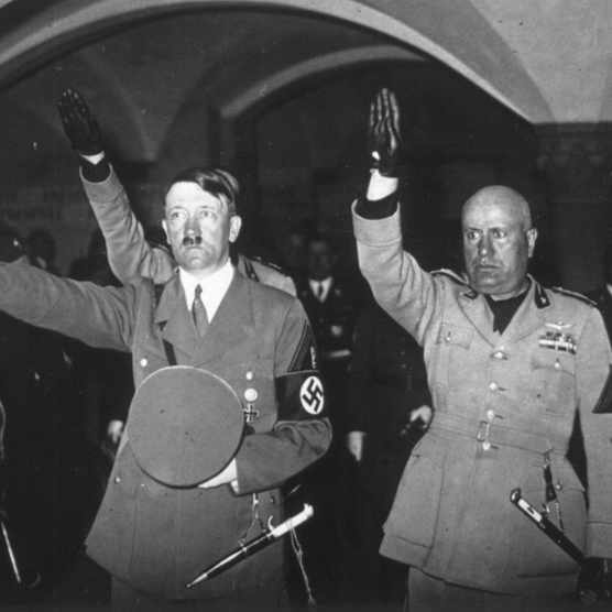 Adolf Hitler and Benito Mussolini give a fascist salute