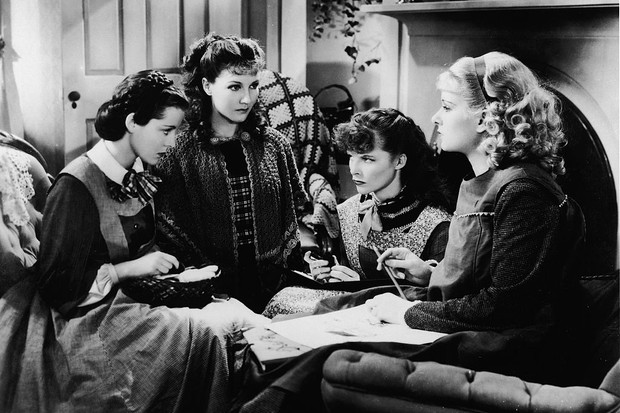 American actresses Frances Dee, Jean Parker, Katharine Hepburn, and Joan Bennett playing the March girls in George Cukor's film adaptation of Louisa May Alcott's 'Little Women', 1933. (Photo by RKO Pictures/Courtesy of Getty Images)