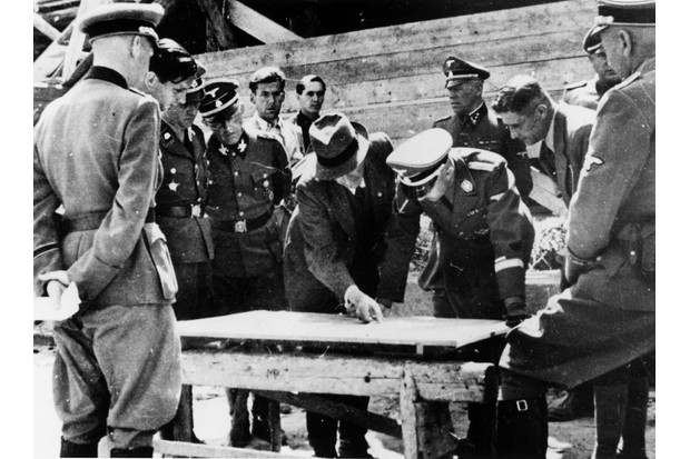 Engineer Max Faust shows SS commander Heinrich Himmler plans for part of the Auschwitz complex in 1942