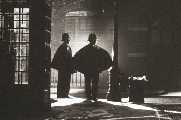 Policemen from Scotland Yard patrolling at night
