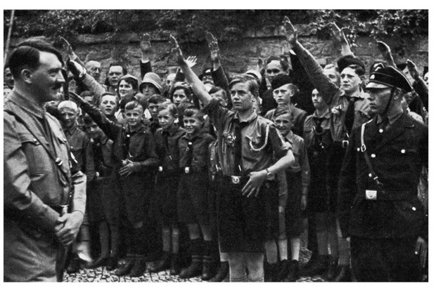 Youths salute Adolf Hitler