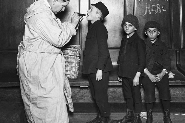 Immigrant children are examined by a city health officer upon arrival at the battery from Ellis Island during a Typhus scare, c1911. (Image by Bettmann/Getty Images)