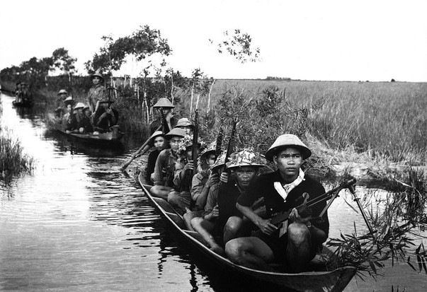 A group of Viet Cong patrolling in a rice paddy