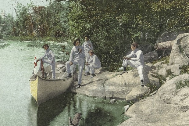 Postcard of a group of men wearing identical clothing boarding a boat for a stag party, c1914. (Photo via Smith Collection/Gado/Getty Images).