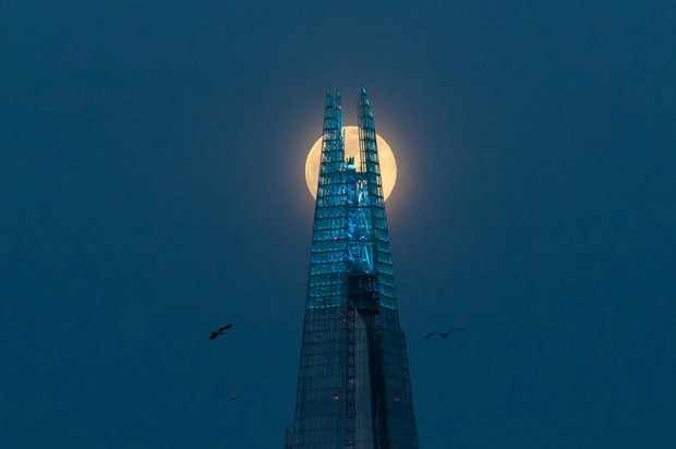 The pink moon rises over the Shard in London (Photo by Wiktor Szymanowicz/Barcroft Media via Getty Images)
