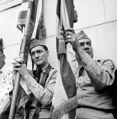 A veteran holding a flag