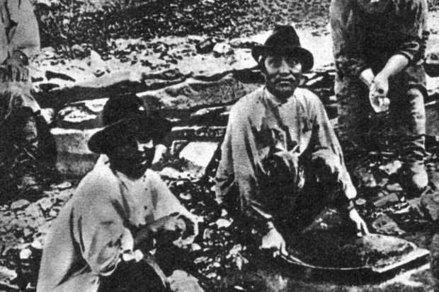 Prospectors pan for gold in Siberia during the 19th century.