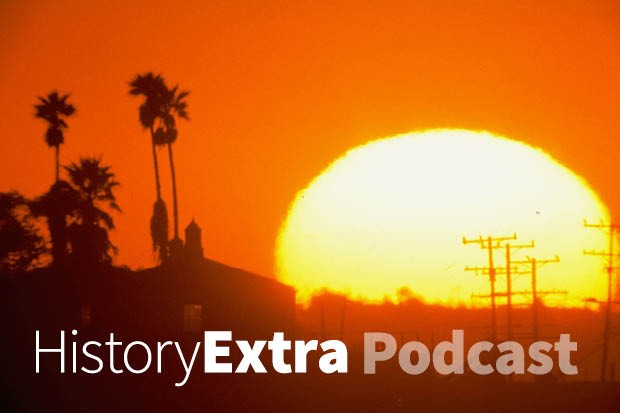 Huge sun setting over power lines and palm trees in California. (Photo by Getty Images)