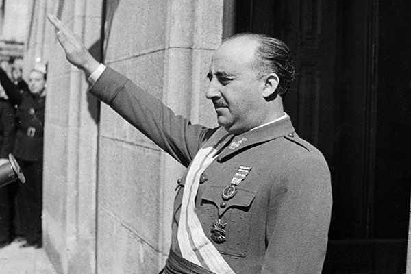 Francisco Franco, who ruled Spain as dictator from 1939 to 1975, raises his arm in salute