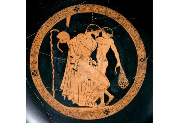 Athenian red-figure cup showing a seated man with a naked boy in the inside tondo, 470 BC