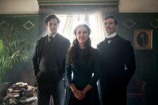 Enola Holmes (left to right): Henry Cavill as Sherlock Holmes, Millie Bobby Brown as Enola Holmes, Sam Caflin as Mycroft Holmes. (Photo by Robert Viglaski/Legendary)