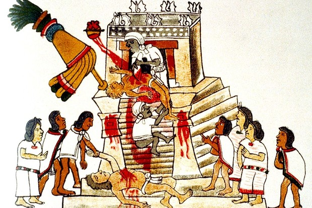 Priest offering the heart taken from a living human victim to the Aztec sun god and god of war, Huitzilopochtli. Print of facsimile from Aztec Codex, published 1904. Human Sacrifice (Photo by Universal History Archive/Getty Images)
