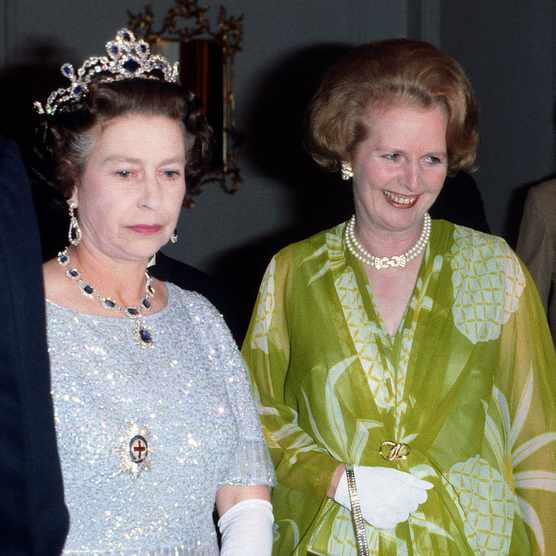 Queen Elizabeth II and Prime Minister Margaret Thatcher attend a ball to celebrate the Commonwealth Heads of Government Meeting, 1979 in Lusaka, Zambia. (Photo by Anwar Hussein/Getty Images)