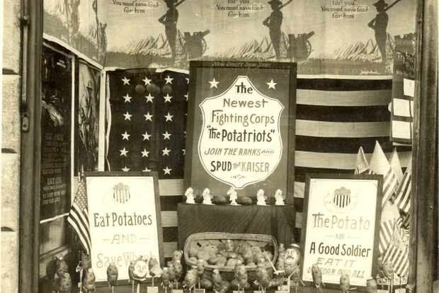 """A shop in Iowa urges """"potatriots"""" to """"Join the ranks and spud the kaiser"""". With huge amounts of wheat being shipped to Europe, America's wartime government actively promoted potato consumption. (Photo by NARA)"""