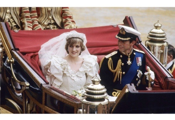 Diana and Charles being driven to Buckingham Palace after their wedding