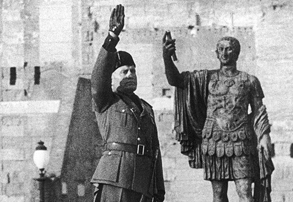 Mussolini salutes in front of the statue of the Roman emperor Nerva, in the 1930s