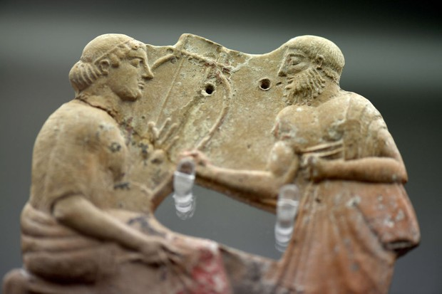 Terracotta plaque which is believed to show the poet Sappho rejecting an amorous advance by her contemporary who is also from the island of Lesbos. (Photo by Finnbarr Webster/Getty Images)