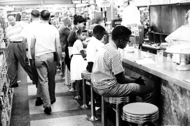 Young civil rights activists sit in defiance at a 'whites only' lunch counter in Oklahoma City, 1958