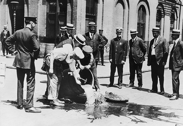 Alcohol is poured away into a New York sewer during the prohibition era, c1920