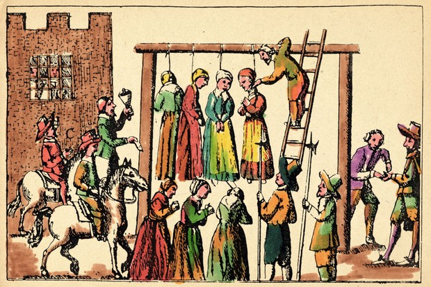 17th century engraving showing the execution by hanging of four witches. (Photo by Fototeca Gilardi/Getty Images)