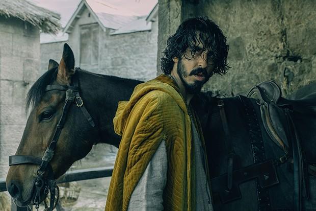 Dev Patel stars as Sir Gawain in The Green Knight an adaptation of the Arthurian romance Sir Gawain and The Green Knight