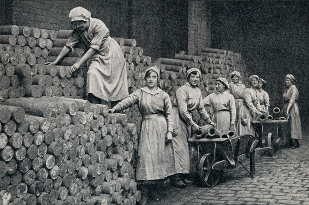 Women munition workers stacking a reserve of shell castings during WWI