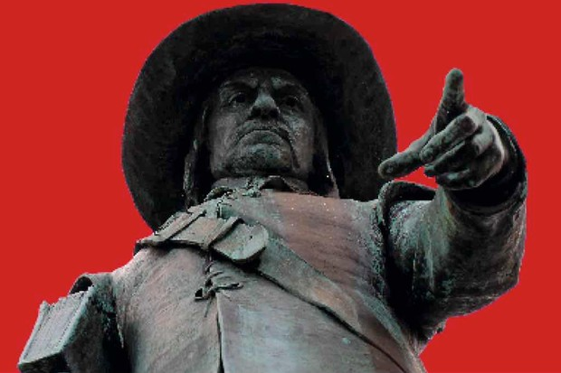 A statue of Oliver Cromwell stares downwards, against a red background