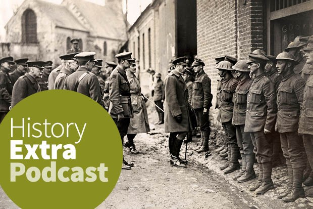 A black-and-white image shows King George V inspecting soldiers