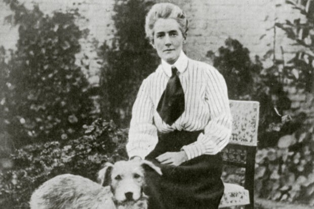 Portrait of First World War nurse Edith Cavell with one of her dogs