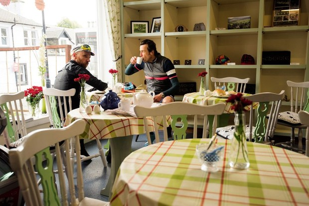 Two cyclists in a tea shop