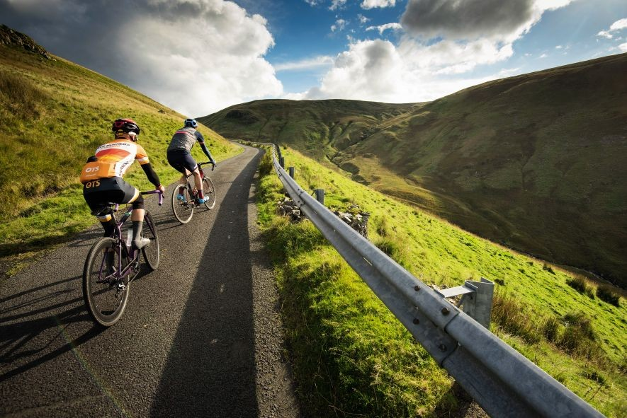 Two cyclists riding in the alps