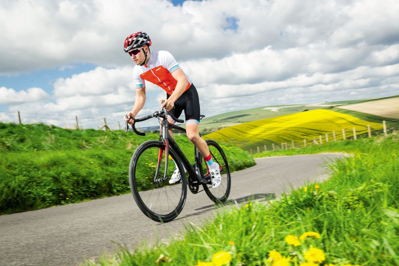 A cyclist riding a Trek Domane SLR9 in the English countryside