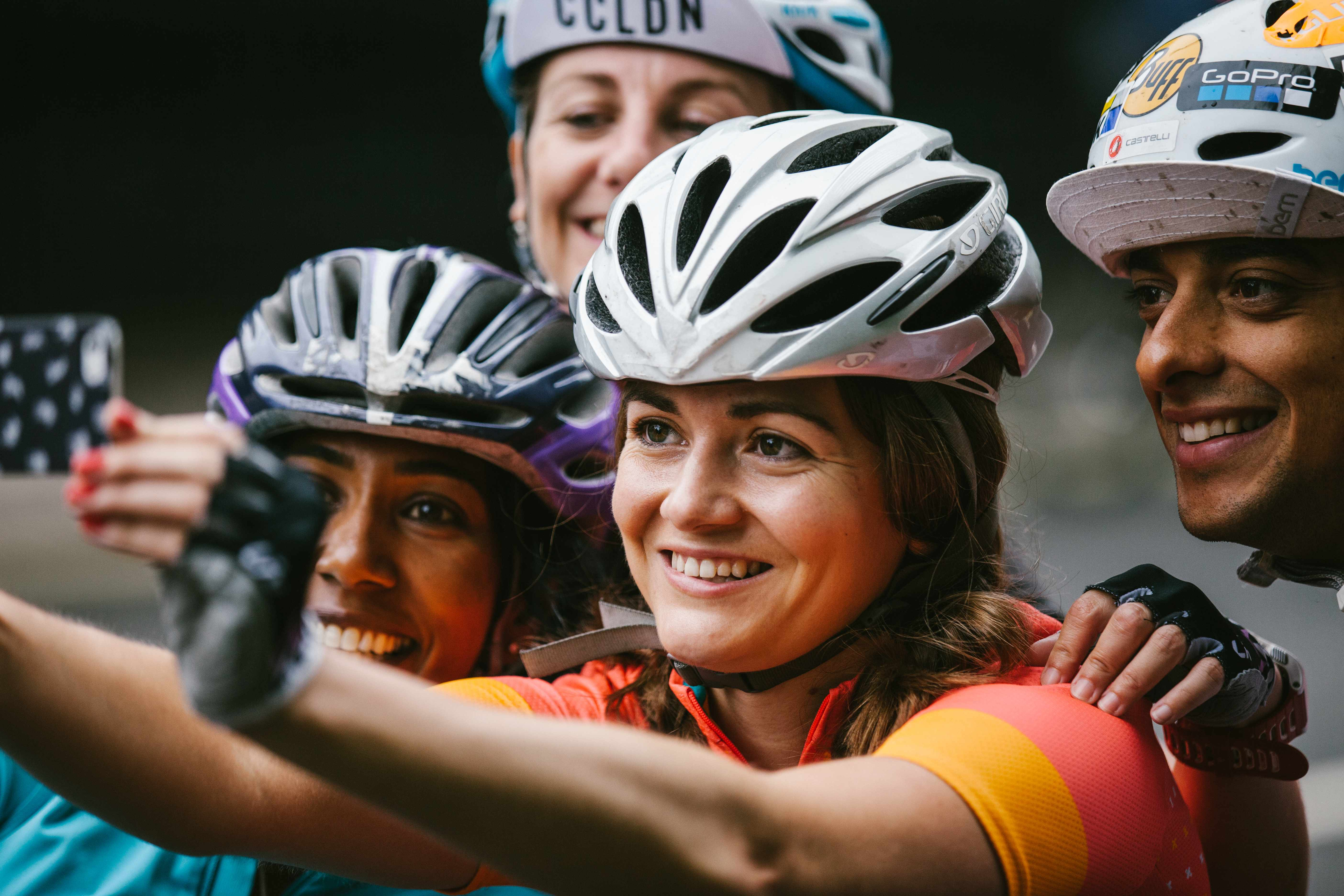 Three female cyclists posing for a selfie