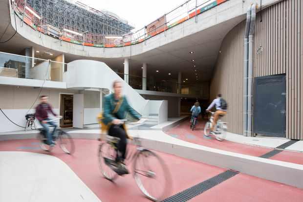 Cyclists in a huge underground bike park in Utrecht Holland