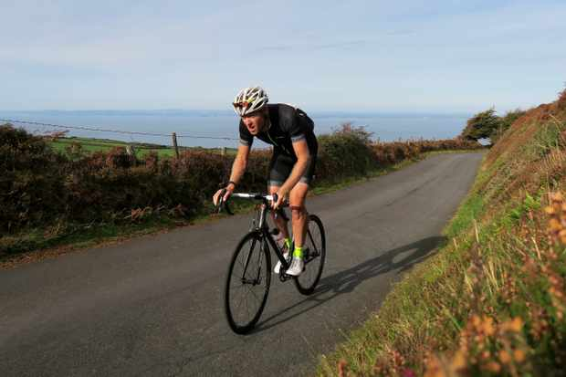 Author Simon Warren rides the Porlock Toll Road climb in Somerset