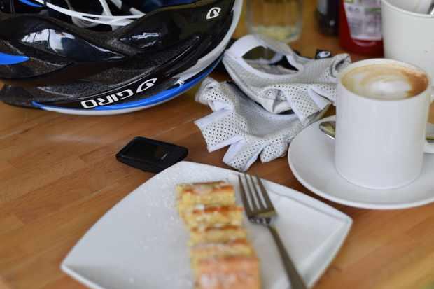 A cake, coffee and bike bits.