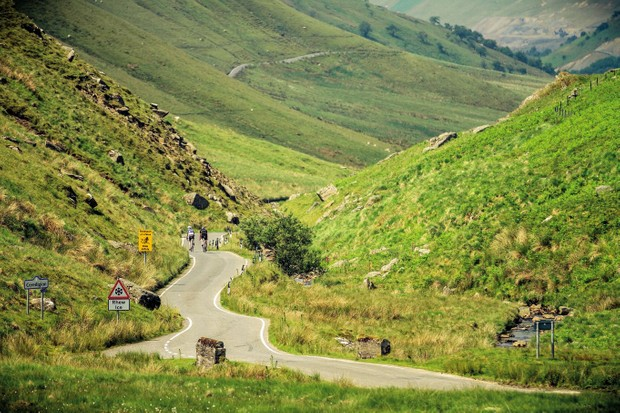 Two cyclists riding into the distance in the Elan Valley Wales