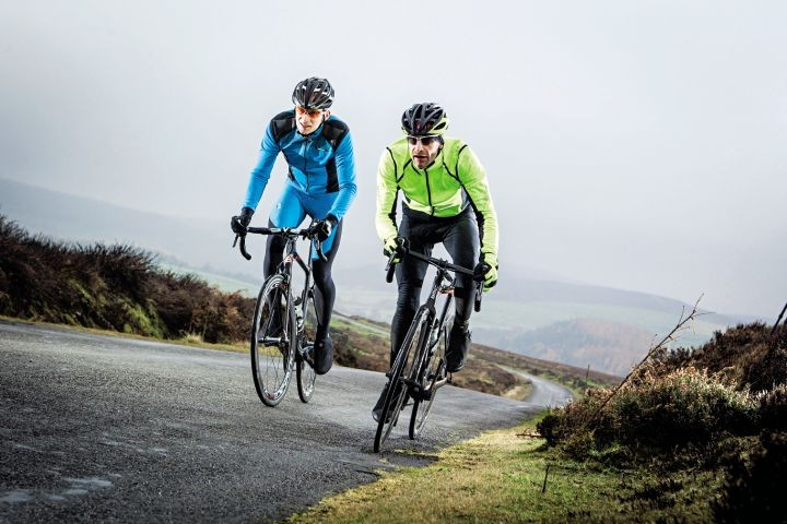 Two cyclists racing hard uphill in the North Yorkshire Moors
