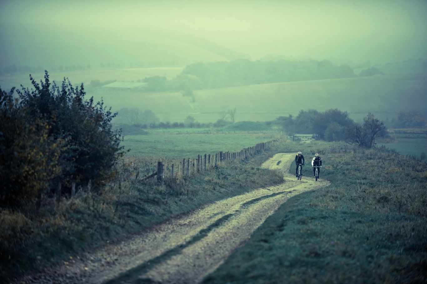 Long shot of two cyclists riding on the Ridgeway, England's oldest road