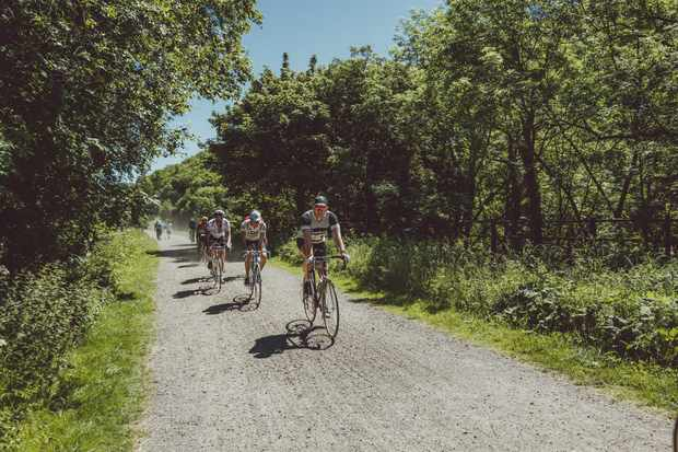 Riders on a gravel trail at Eroica Brittania, 2017. Peak District, Derbyshire, England