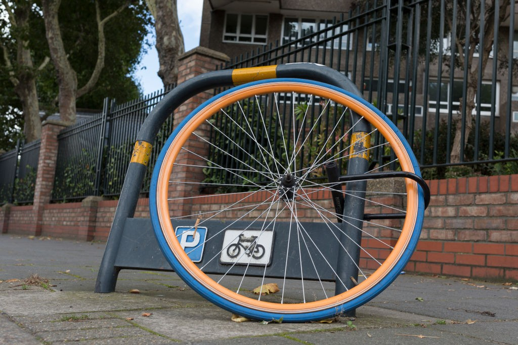 After the rest of the bike has been stolen, a lone wheel remains locked to a bike stand, on 11th September, 2017, in London, England. (Photo by Richard Baker / In Pictures via Getty Images)